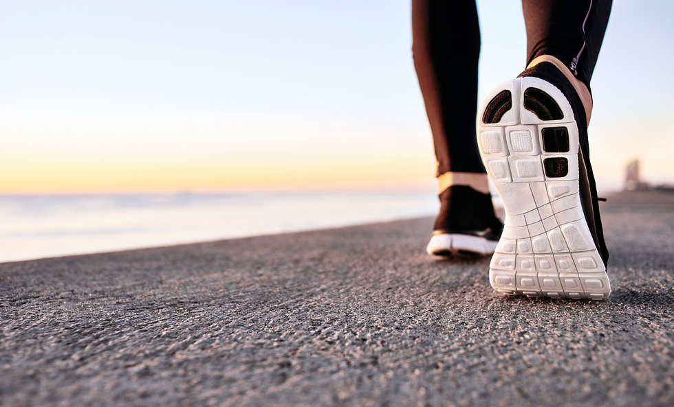 closeup-of-sport-shoes-on-concrete-path.