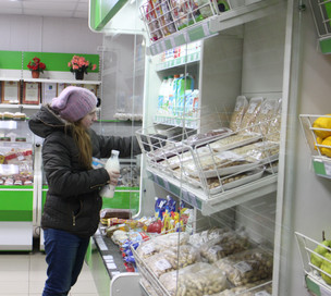 How do orphans cope financially after exiting the Russian orphanage system?