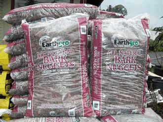 """One of the best products around in Southern Californian nurseries is """"Bark Nuggets"""" by Earthgro. These small redwood bark nuggets are great for rosebeds, decaying in several seasons before needing replenishment; and relatively inexpensive too!"""