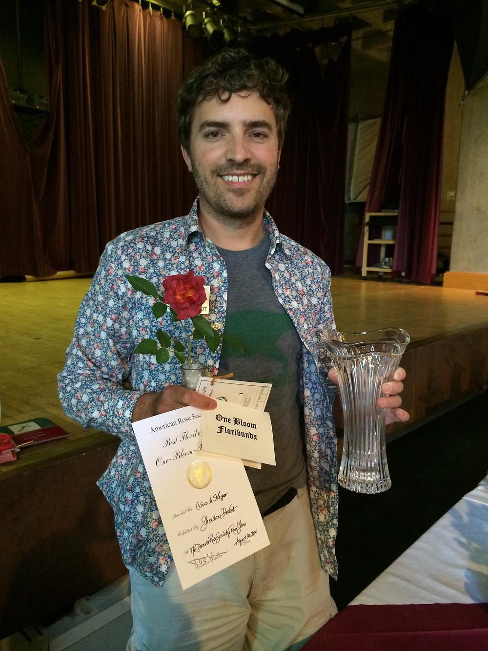 Sheldon with a his winning floribunda at the Boulder Rose Society Rose Show, photo courtesy Sheldon Drobot.