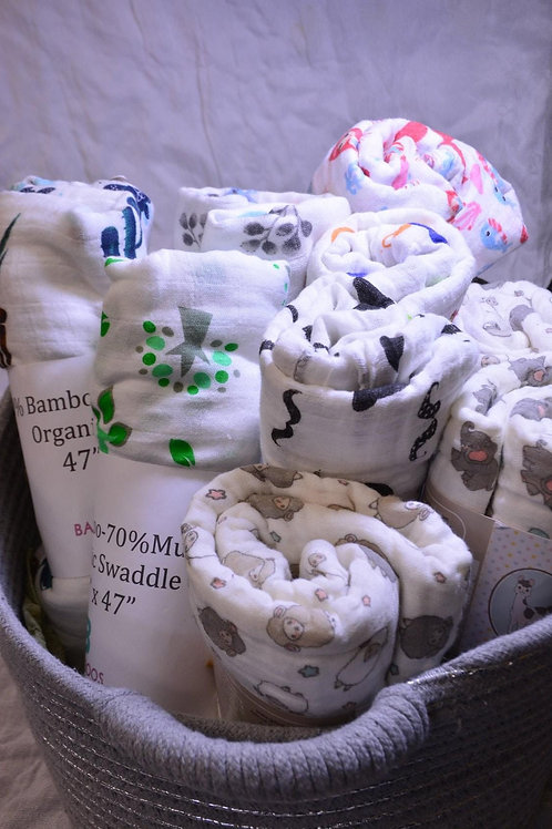 Assorted swaddle blankets, variety of sizes and prices