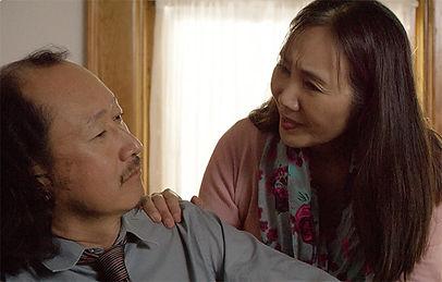 Akiko Shima as Hiroko counsels Naoyuki Ikeda's Takeshi