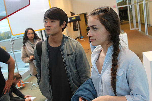 Maya Vasser, Kento Matsunami, & Lucía Rodriguez-Nelson await the next take
