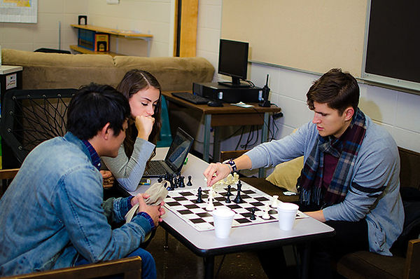 Kento Matsunami, Lucía Rodriguez-Nelson, & Billy Chengary play chess during a break