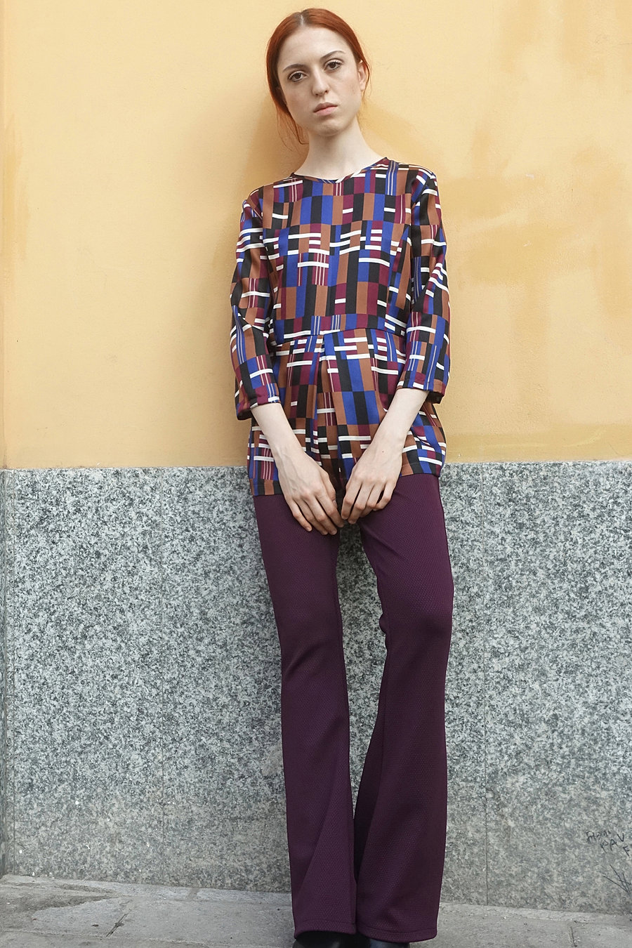 printed silk blouse and purple jersey trousers