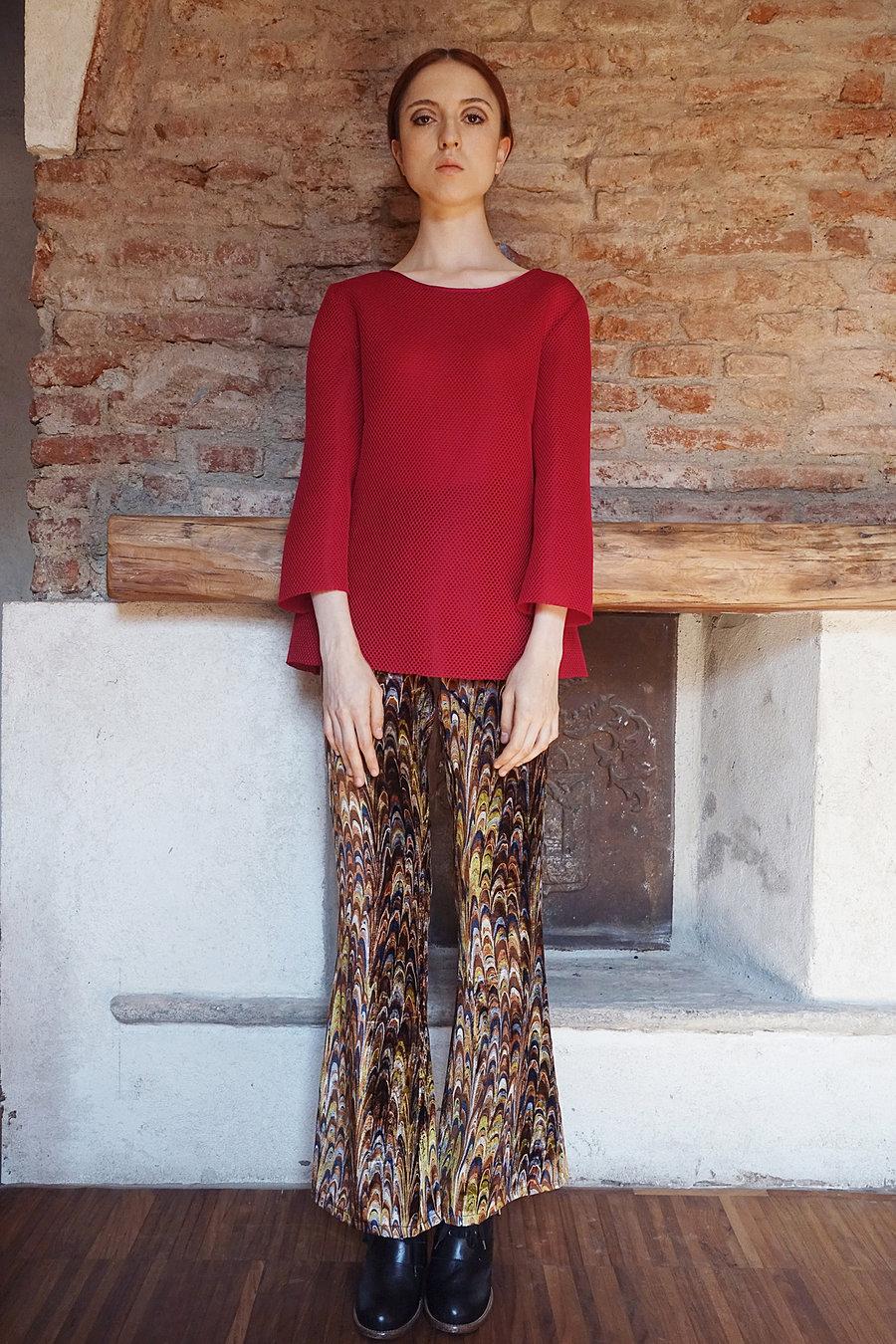 Neoprene outwear and printed silk velvet trousers