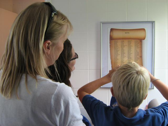 Admiring Plaque of Donations