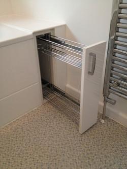 Bespoke end of bath cabinet.