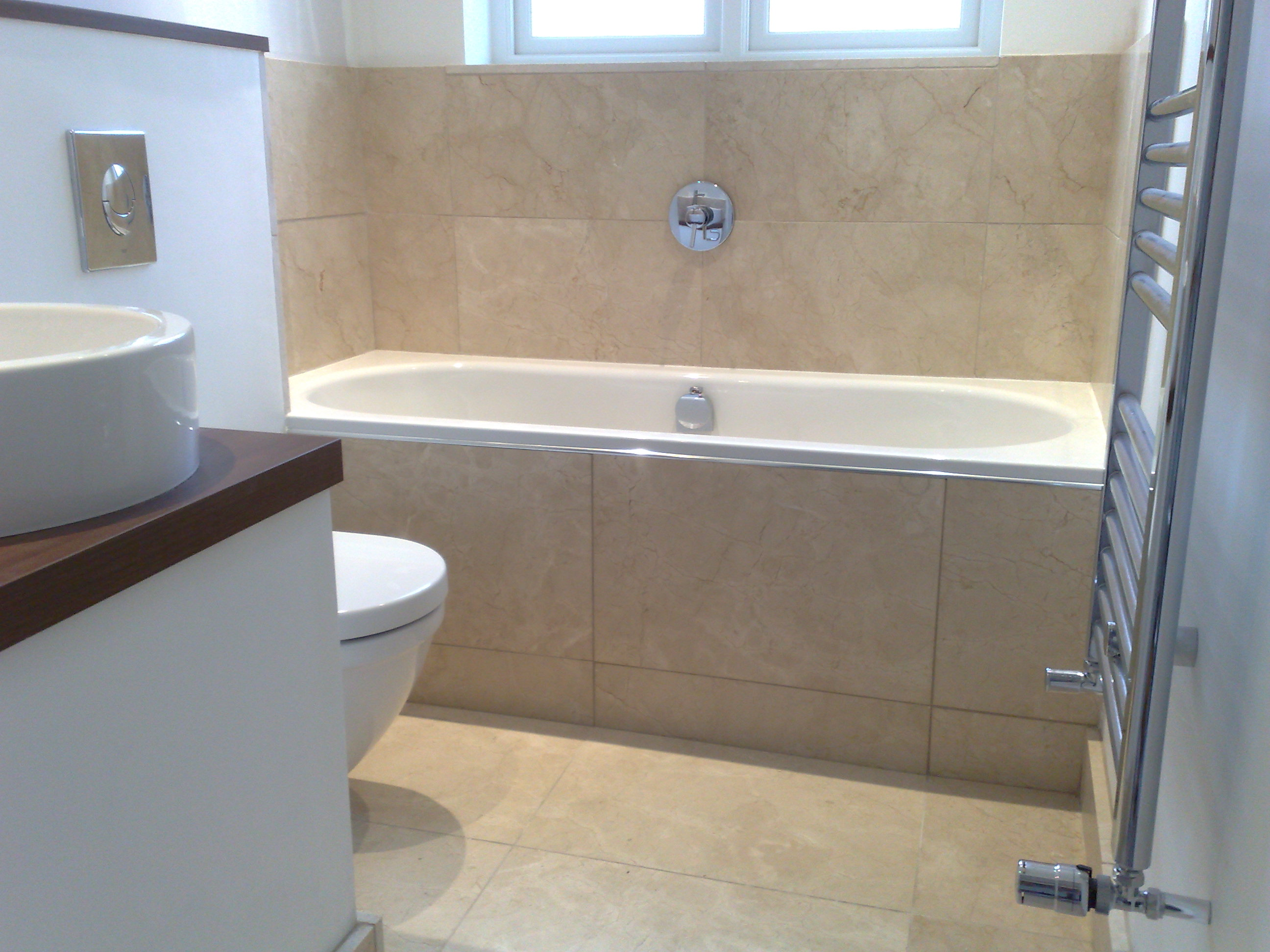 Fully Tiled Bath Panel.