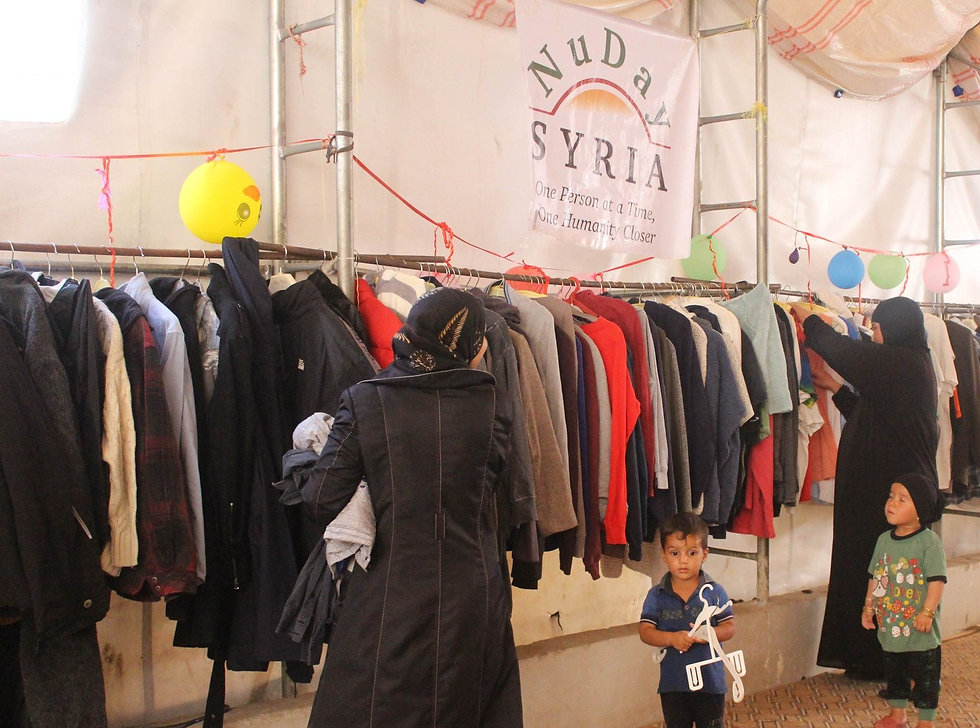 NuDay%20-%20Distribution%20in%20Syria_ed