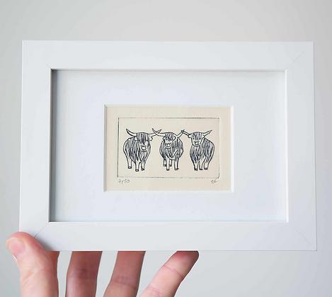 3 Highland Cows Framed Print