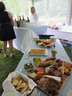 Appetizer table leading to the Bar