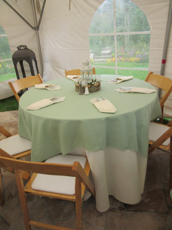 """Natural wood chairs, 48"""" round table and celadon linen"""