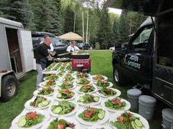 Getting the salad ready for the wedding reception