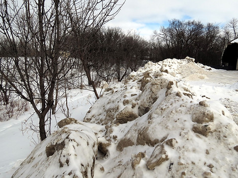 An example of dumping of dirty snow near the river