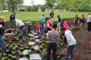 Students volunteering at the initial planting