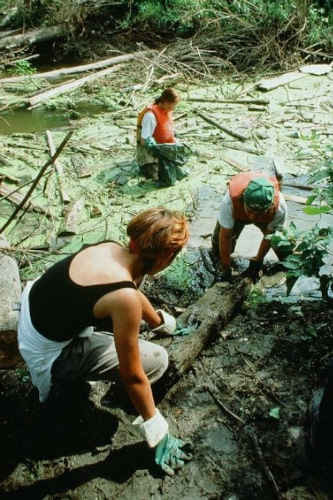 The first SOS Green Team in 1994; Emma (foreground), Eric and Anna in the river.