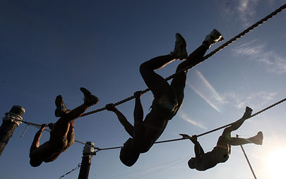 three-man-climbing-on-rope-under-the-sun