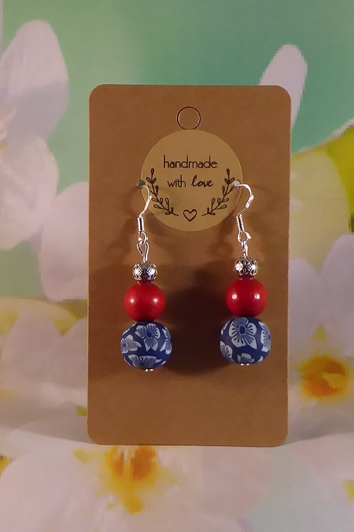 Blue polymer clay bead, red wooden bead and silver filigree
