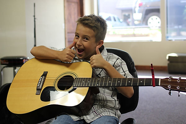 Rock University Student Shows Enthusiasm for his Guitar Lessons