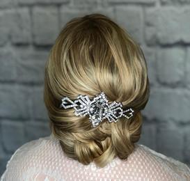 Soft romantic elegant bridal hair up style