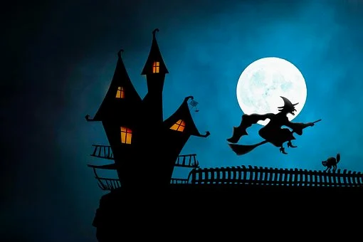 witch flying on broom and haunted house
