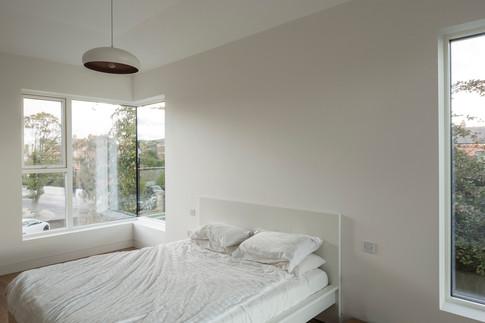 Frameless corner to corner windows of the master bedroom
