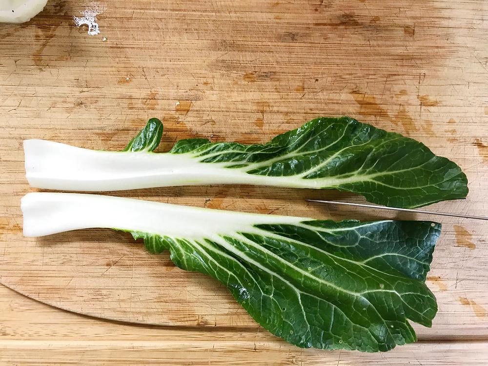 Pak choy leaf halved lengthwise