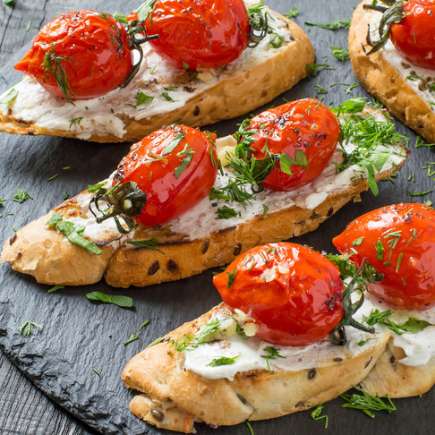 Goat Chèvre and Blistered Tomato Crostini with Fresh Herbs
