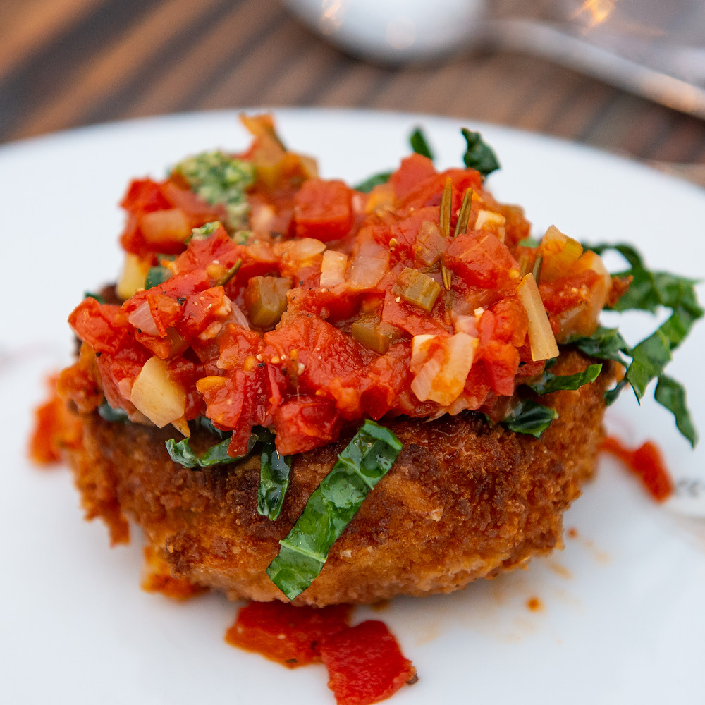 Chunky and Aromatic Homemade Marinara over Eggplant Parmesan & Shredded Kale. Photo: Deborah Chadsey, In Paradise Photography