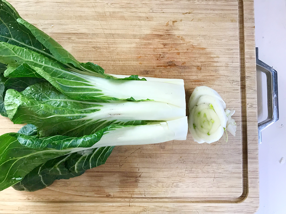 Pak choy with the base and roots cut from the stems and leaves.
