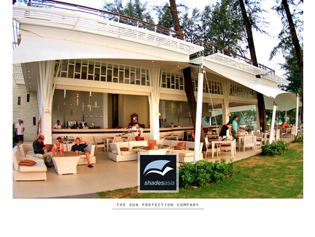 A beautiful solution to adding outdoor dining space with tensile fabric patio roofing.