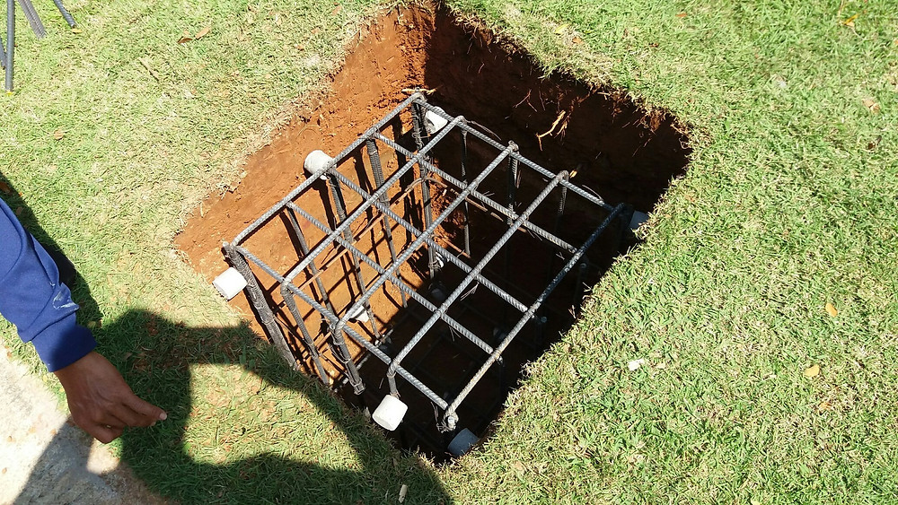footings excavation with steel reinforcing cage