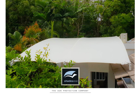Cantilevered rainproof awning for an outdoor kitchen