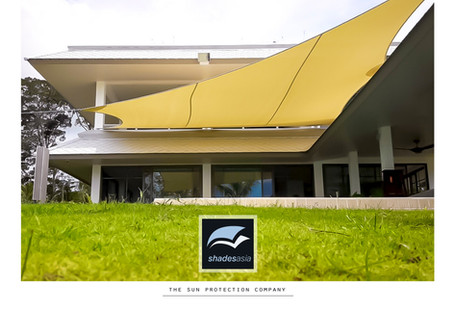 Another shade solution for a swimming pool.