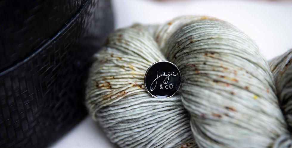 Joji & Co black enamel pin