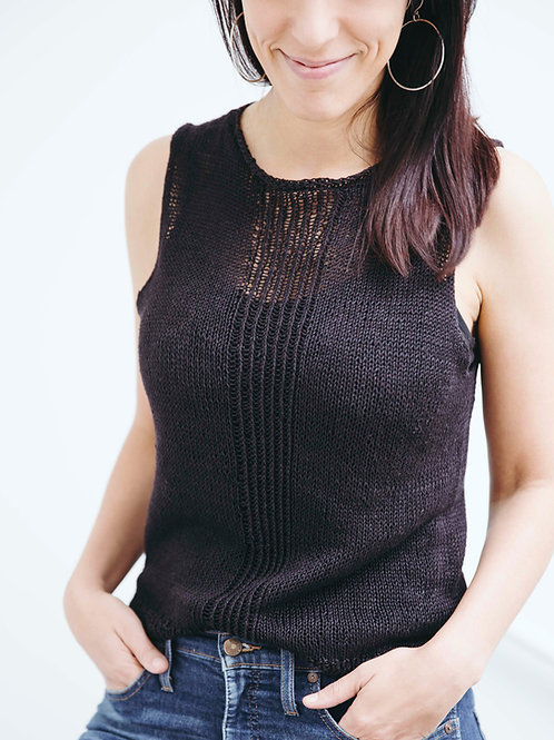 Dark haired woman wearing a hand-knitted linen tank top, black and sleeveless