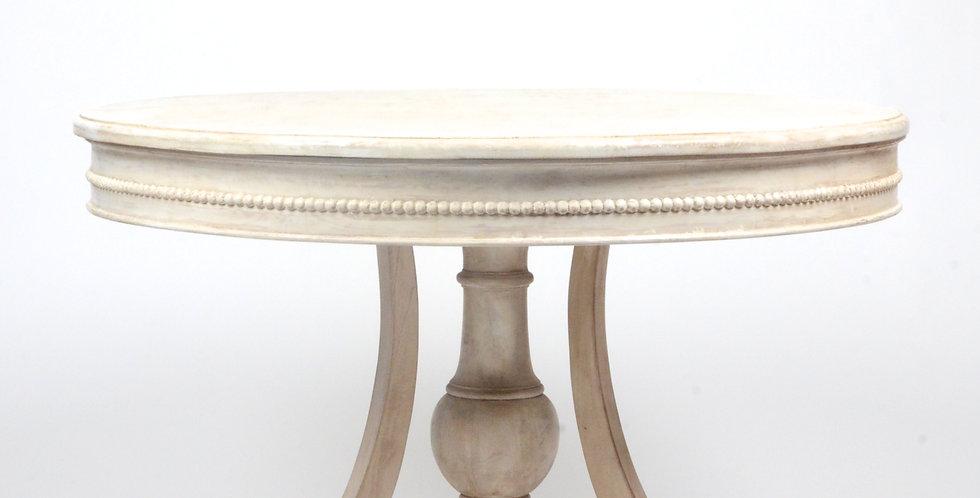White circular wooden table