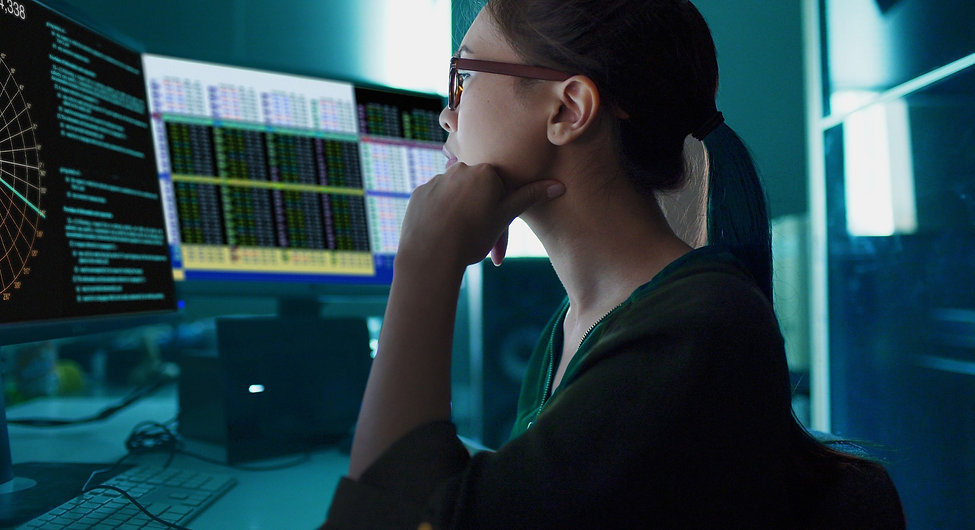 A woman looking at charts on the screen_edited_edited.jpg