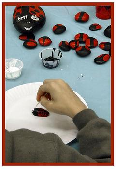boy painting lady bug