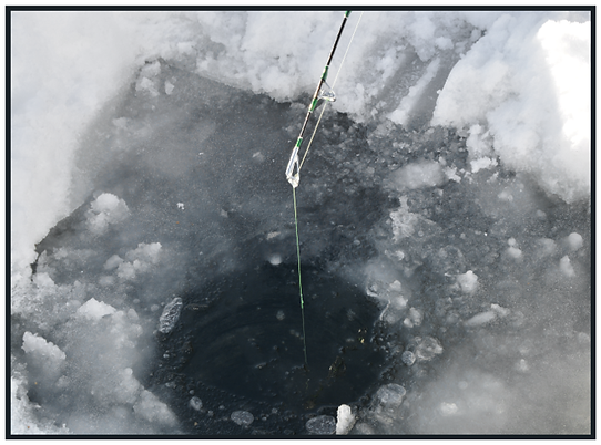 Ice fishing hole close up