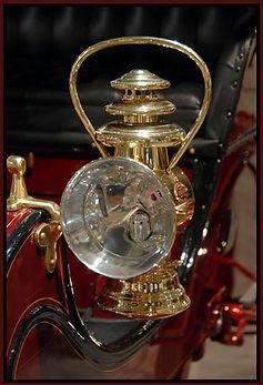 gas light on antique automobile