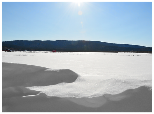 Late afternoon on snow covered lake