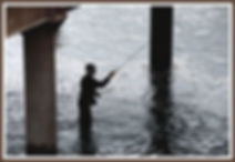 Silouette of a fisherman