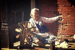 Nepali woman spinning cotton yarn