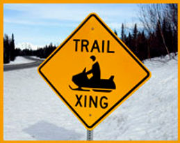 snow machine crossing sign