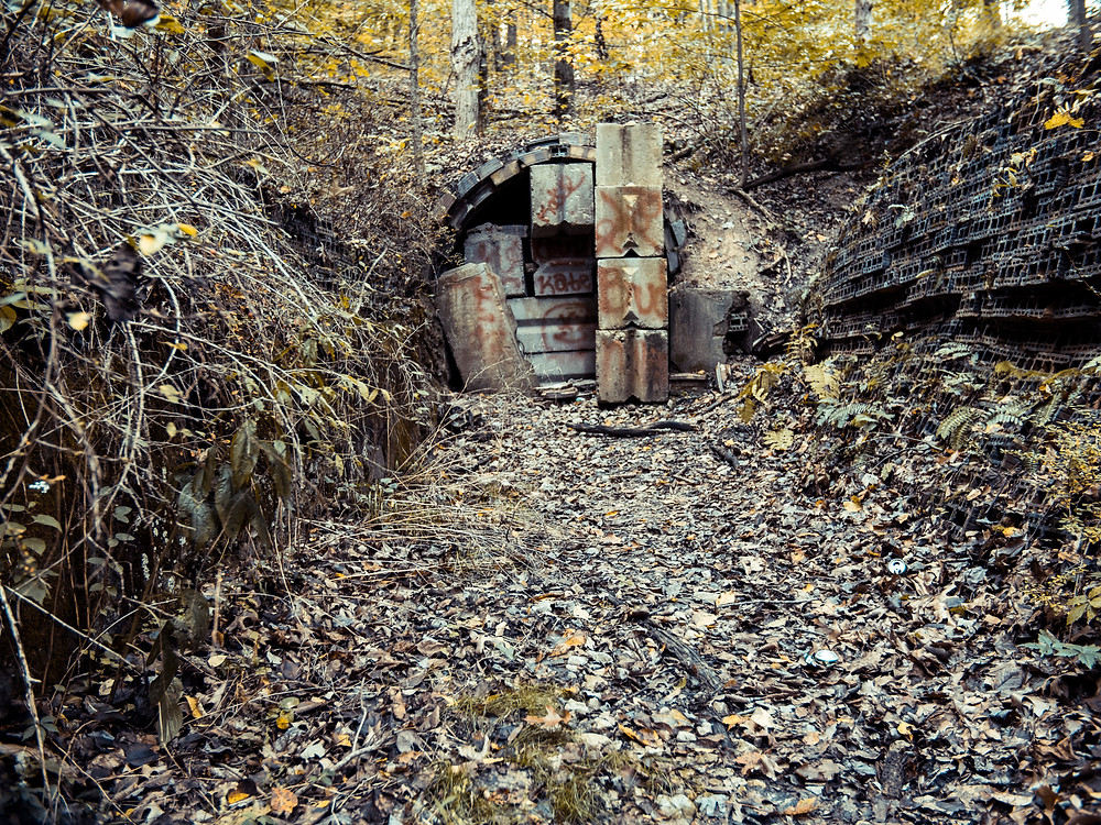 Barricaded entrance to the Haydenville Tunnel (mid-1800s to 1957)