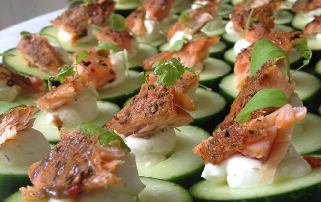 Cucumber blinis with hot smoked salmon.j