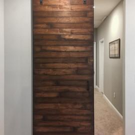 dark wood horizontal slat barn door