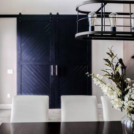 blue painted geometric barn doors